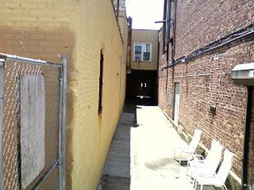 "Back of ""Zombie Alley"" where the alley was cemented up"